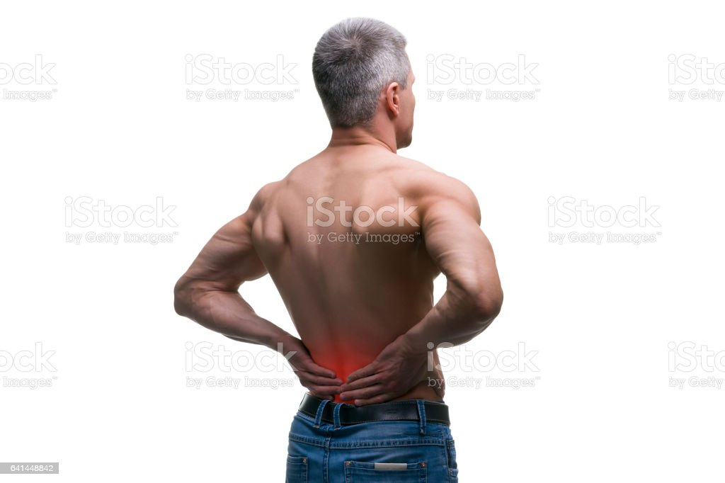 Middle aged man with back pain, muscular male body stock photo