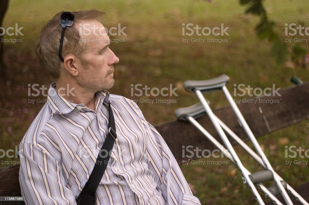 Middle aged man with crutches royalty-free stock photo