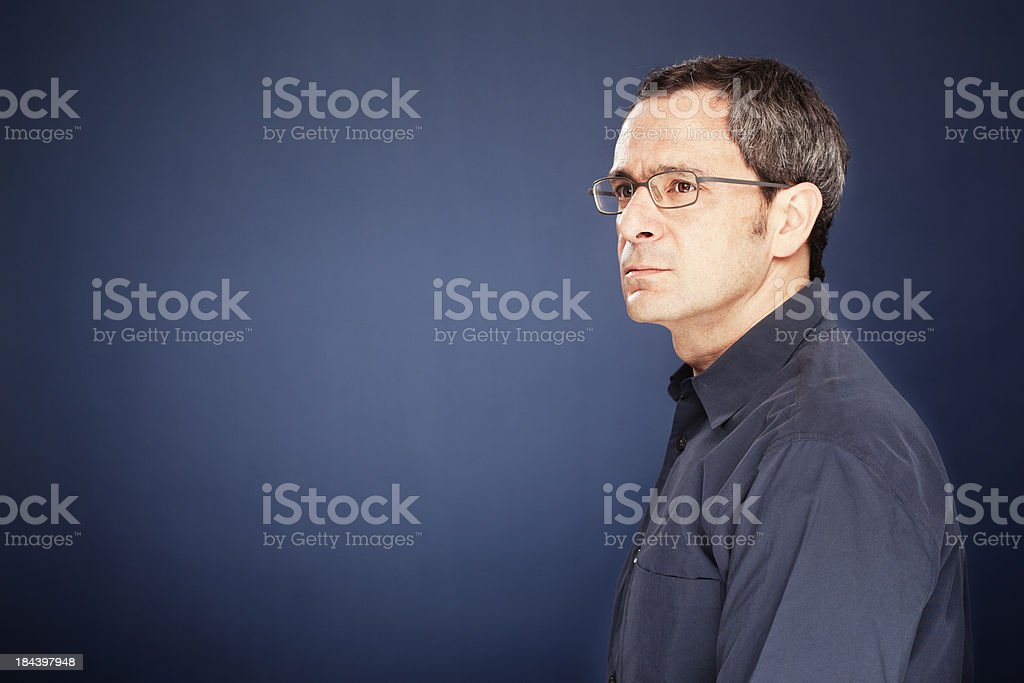 Middle aged man with glasses looking sideways. stock photo