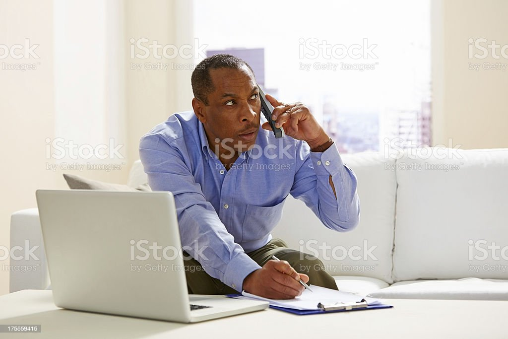 Middle aged man working from home royalty-free stock photo