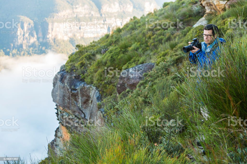 Middle Aged Photographer Bushwalking in Spectacular Blue Mountains Australian Landscape stock photo