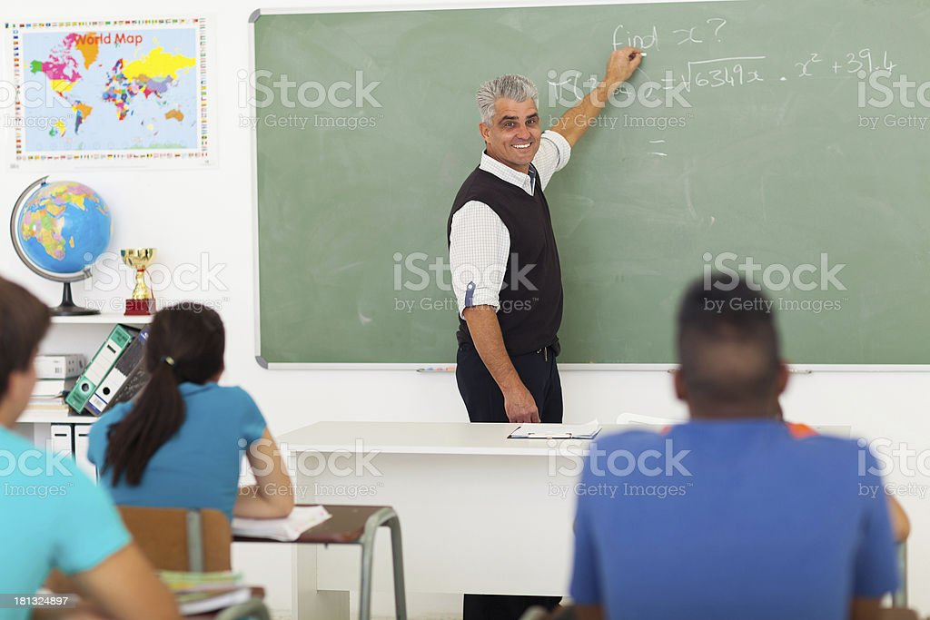 middle aged teacher teaching mathematics royalty-free stock photo