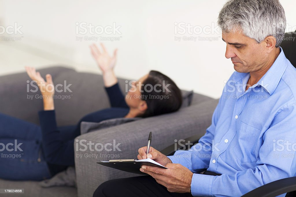 middle aged therapist consulting patient royalty-free stock photo