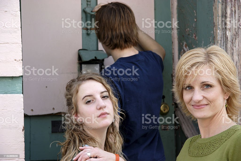 middle aged woman and teens stock photo