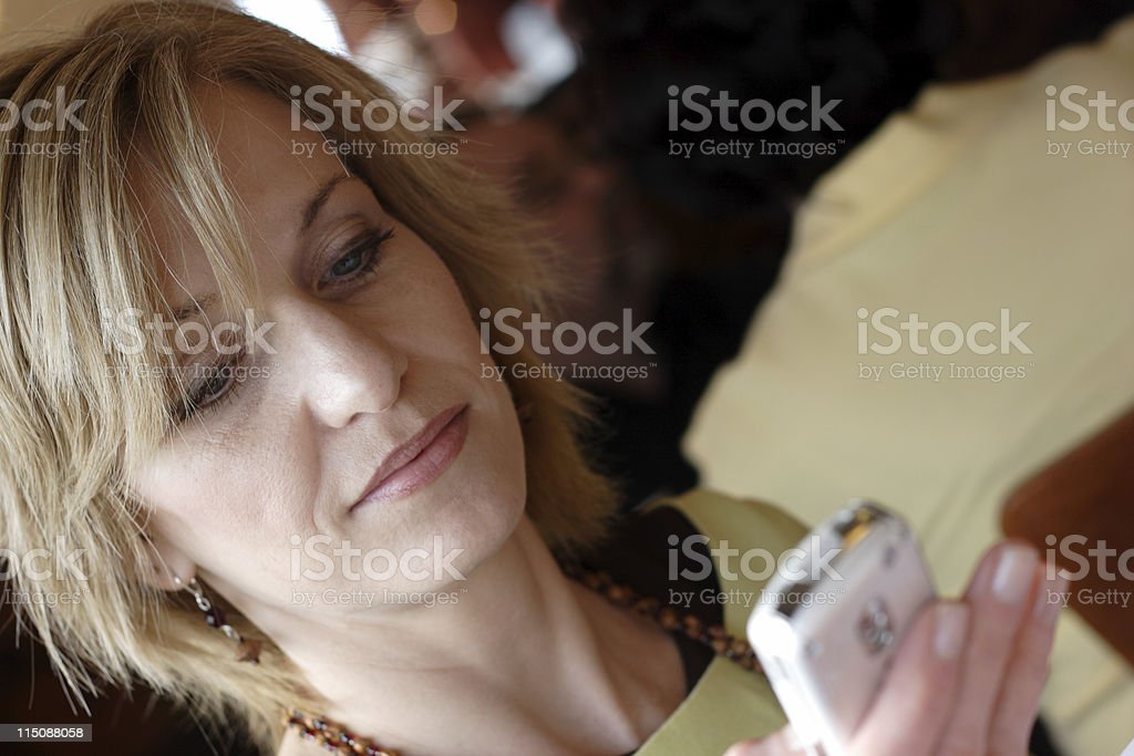 middle aged woman cell phone portrait royalty-free stock photo