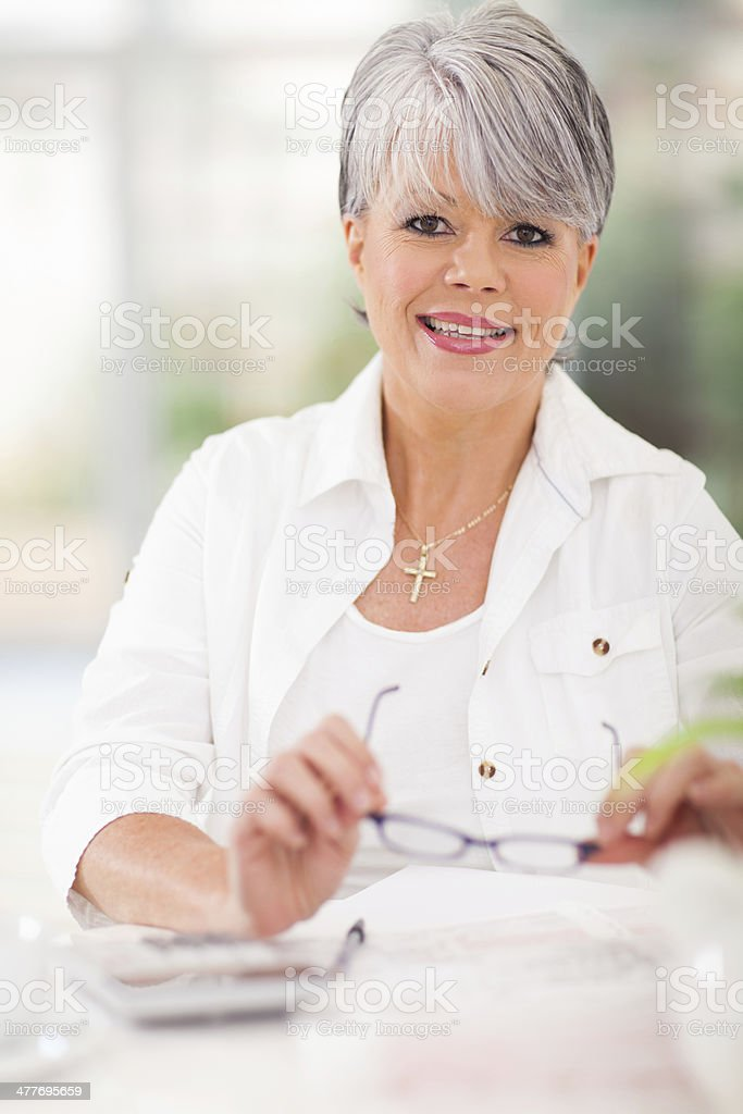 middle aged woman doing home finances royalty-free stock photo