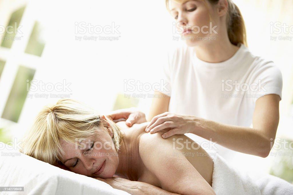 Middle Aged Woman Enjoying Massage stock photo