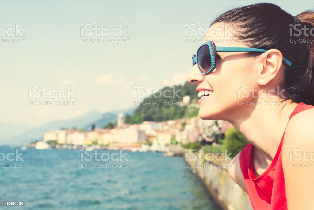 Middle aged woman enjoying view at lake Como, Italy stock photo