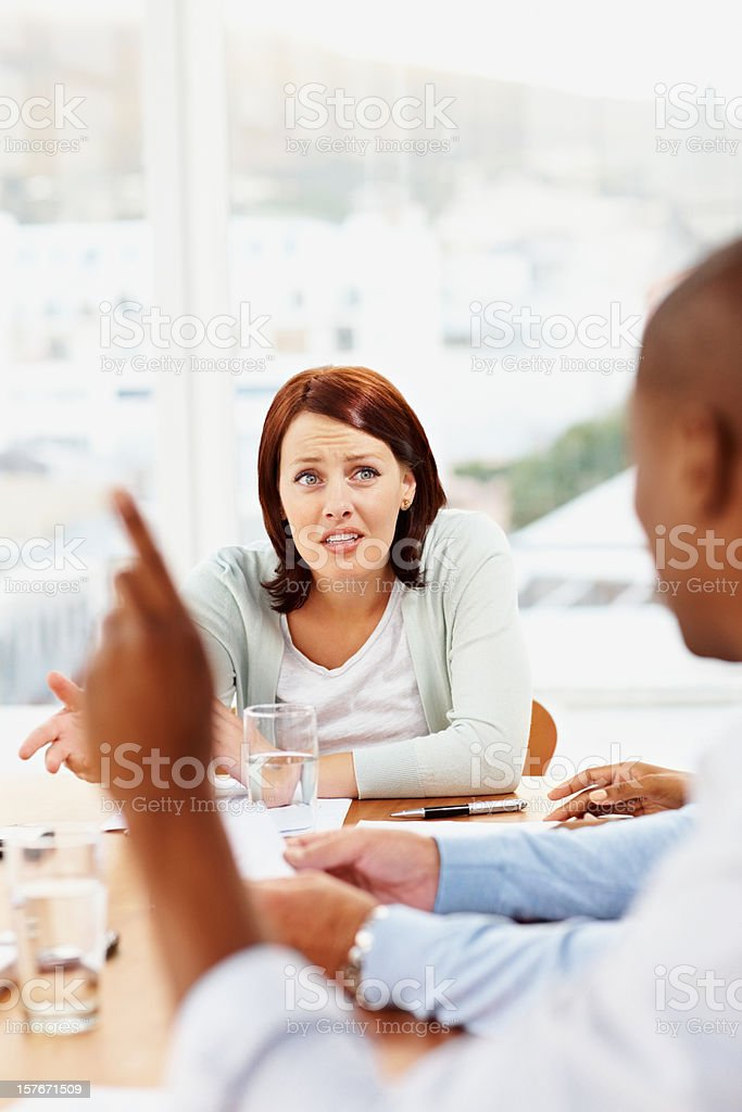 Middle aged woman having a meeting at office royalty-free stock photo