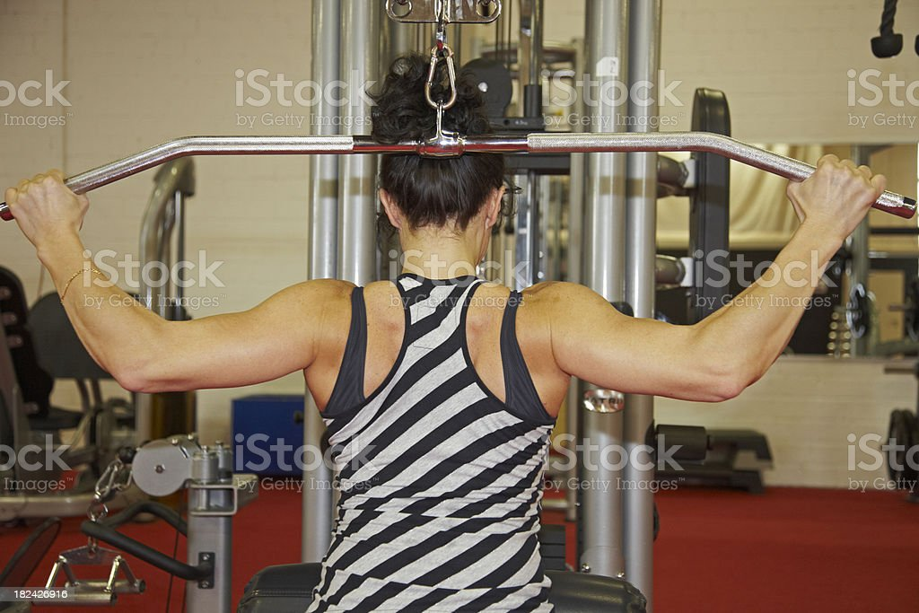 Middle aged woman in a gym stock photo
