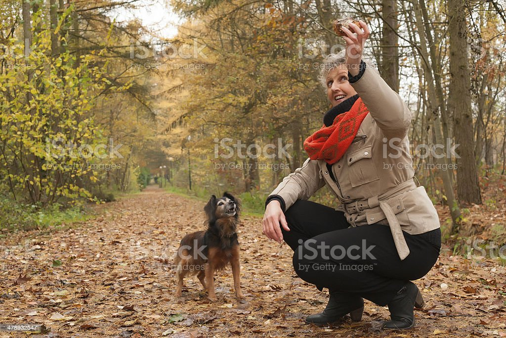 Middle aged woman is thorowing the stick stock photo