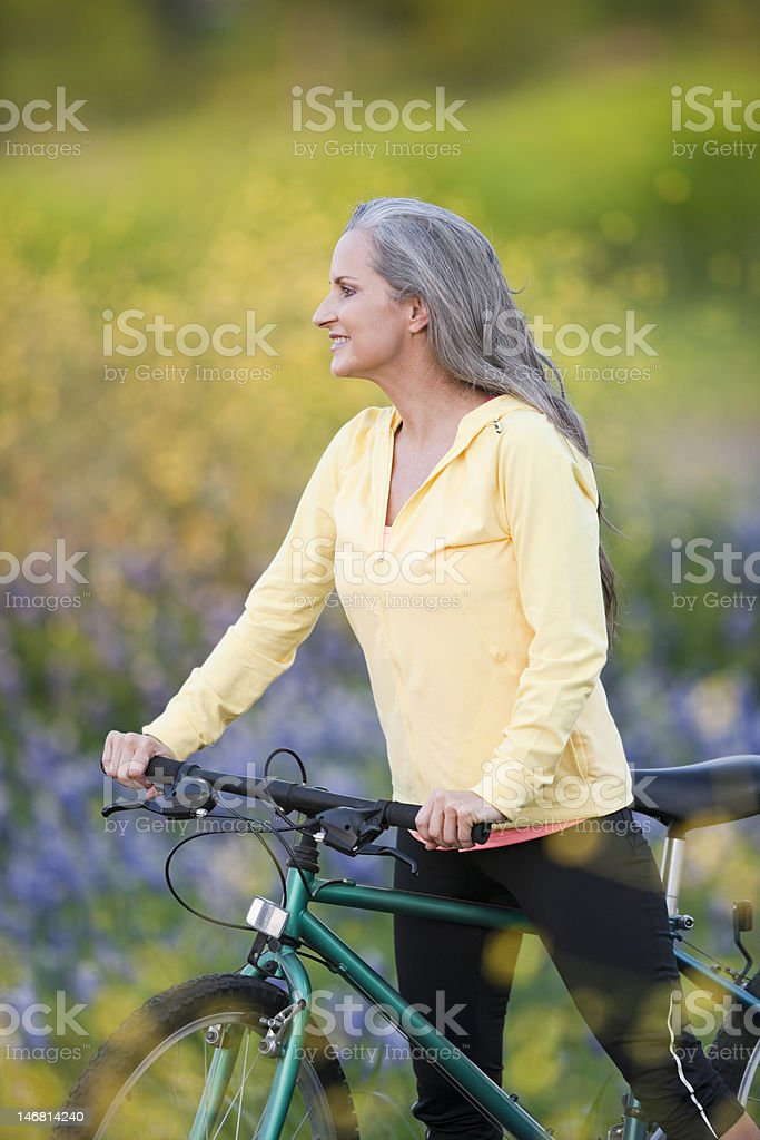 Middle Aged Woman On Bicycle royalty-free stock photo