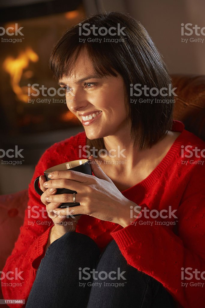 Middle Aged Woman Relaxing With Hot Drink royalty-free stock photo