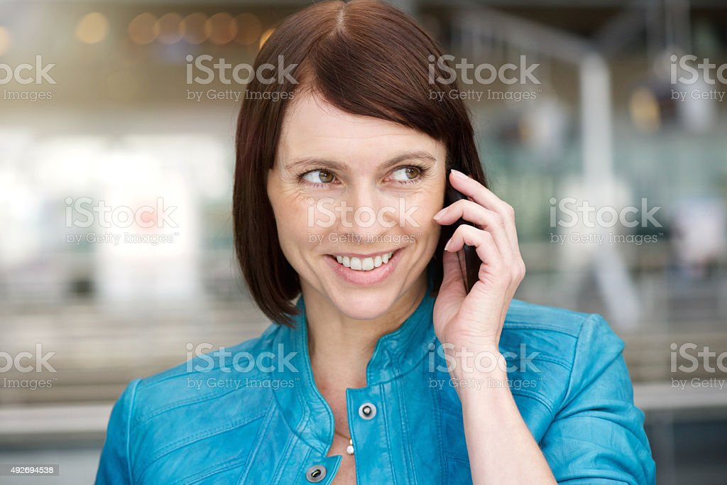 Middle aged woman using cell phone stock photo