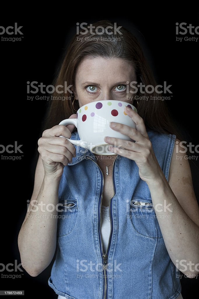 Middle Aged Woman with Beautiful Smile and Coffee Cup royalty-free stock photo