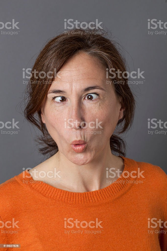 fun middle aged woman with cross-eyed funny face and pouting mouth...