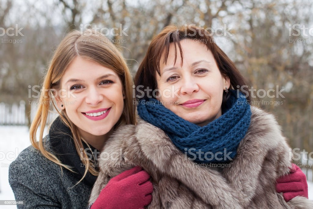 Middle aged woman with her lovely daughter stock photo