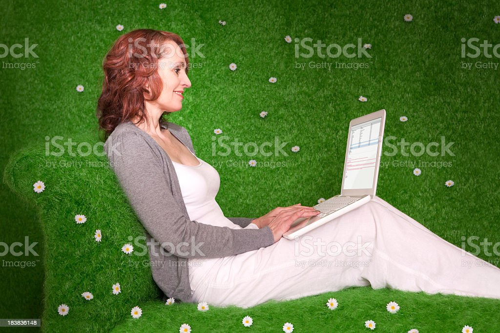 Middle aged woman with laptop royalty-free stock photo