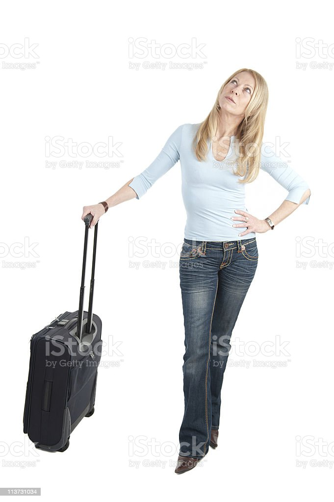 Middle aged woman with wheely bag stock photo