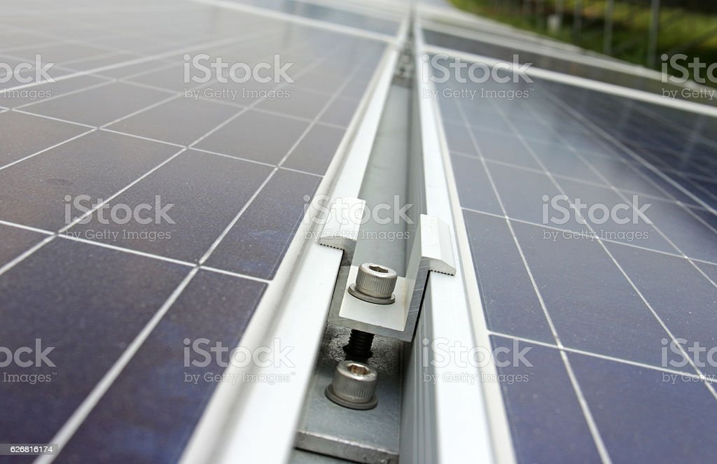 Middle Clamp of Solar PV Panel Installation stock photo