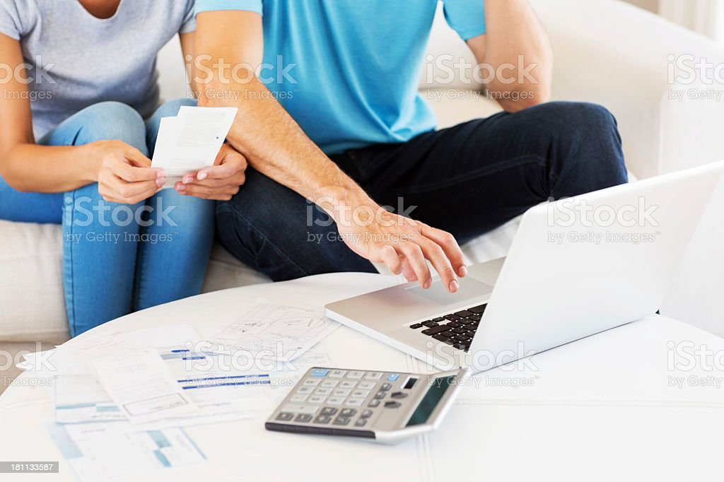 Middle class couple planning budget for home finances stock photo