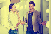 Middle class family couple choosing new refrigerator