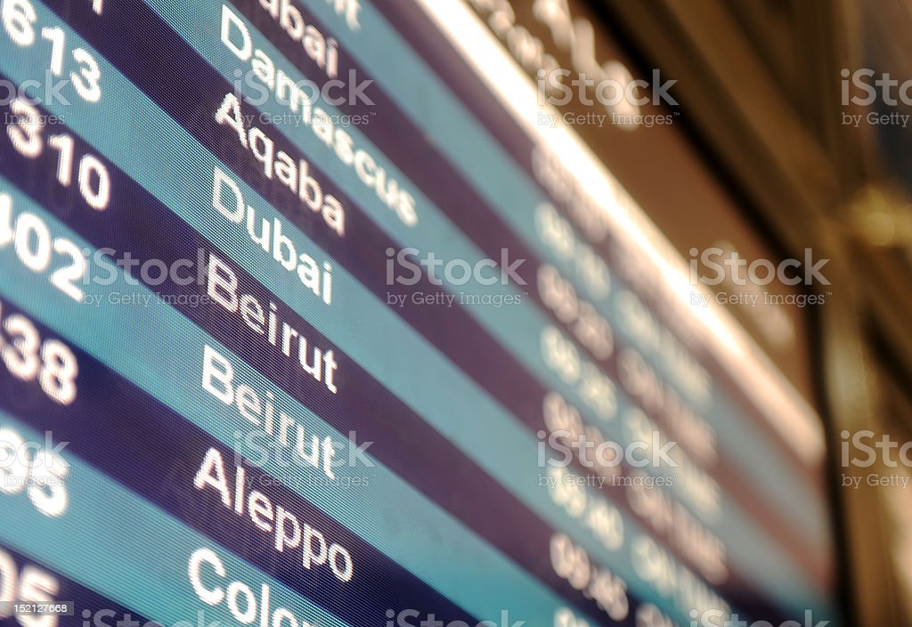 Middle East airport arrivals board stock photo
