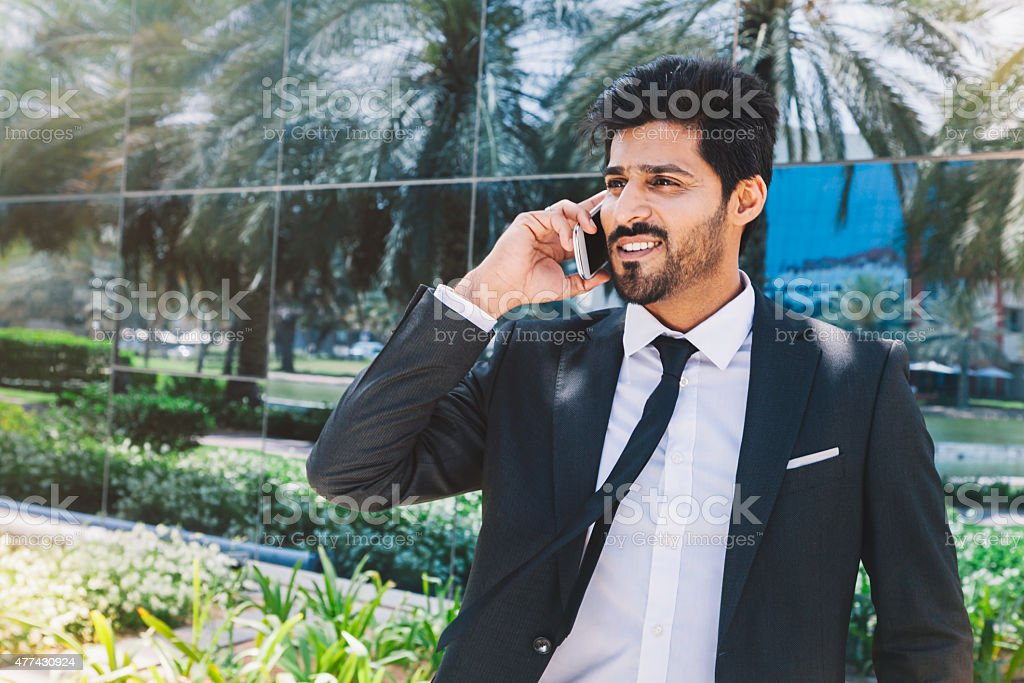 Middle eastern businessman on the phone stock photo
