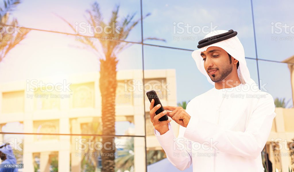 Middle Eastern businessman standing outside stock photo