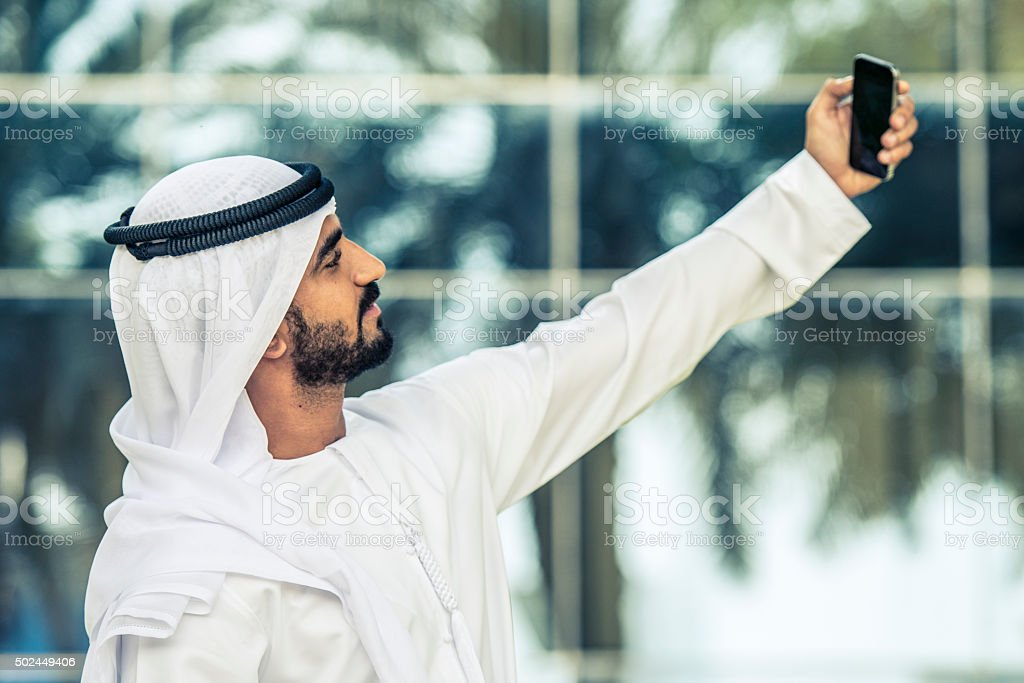 Middle Eastern businessman taking selfie stock photo