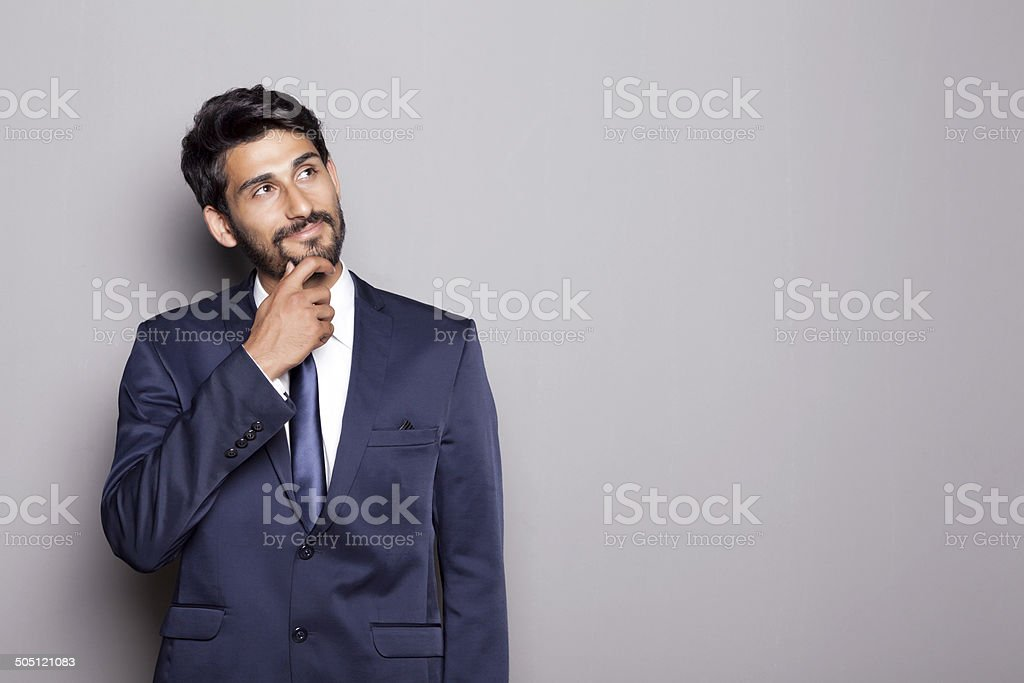 Middle Eastern Businessman Thinking stock photo