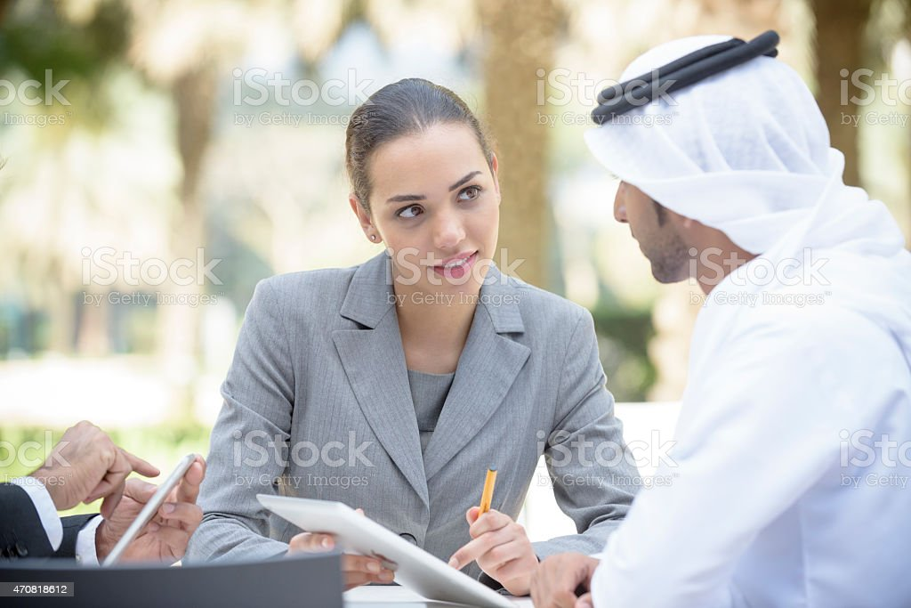 Attractive young middle eastern businesswoman in western business...