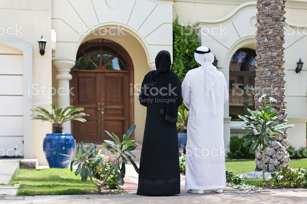Middle Eastern couple looking their new home stock photo