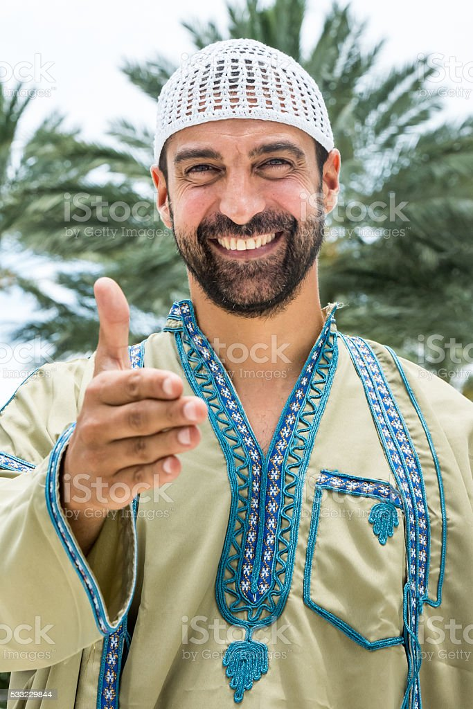 Middle eastern man offering for hand shake stock photo