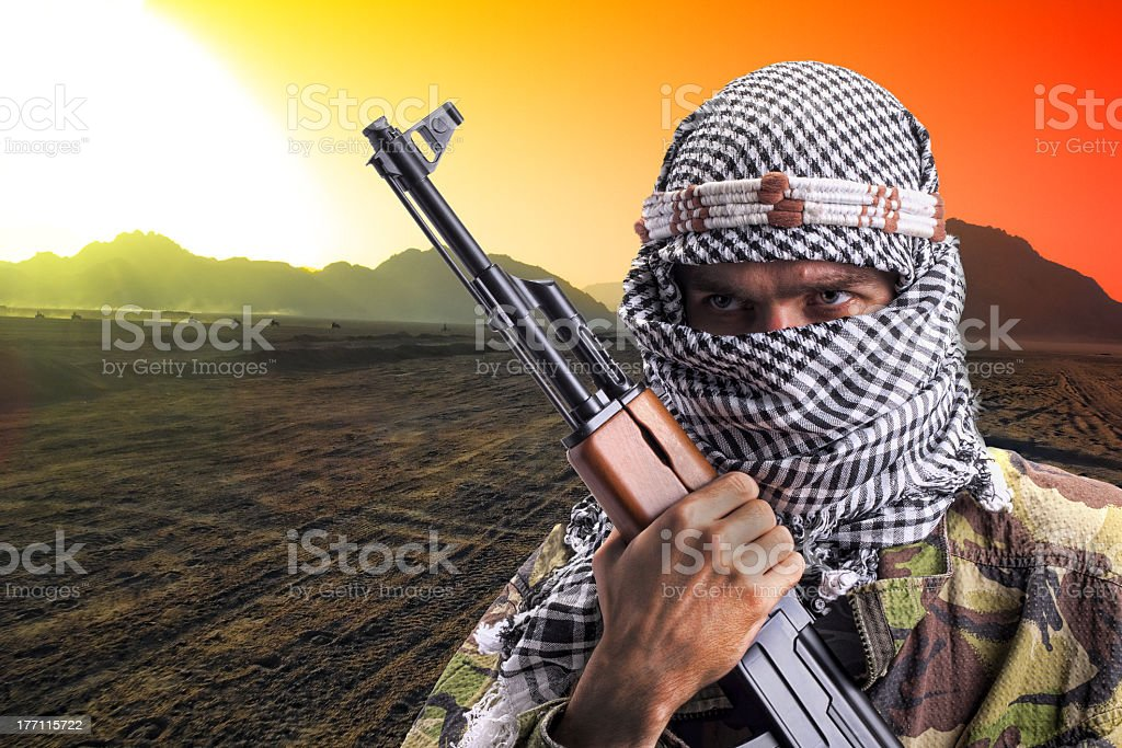 A middle eastern man ready for combat stock photo