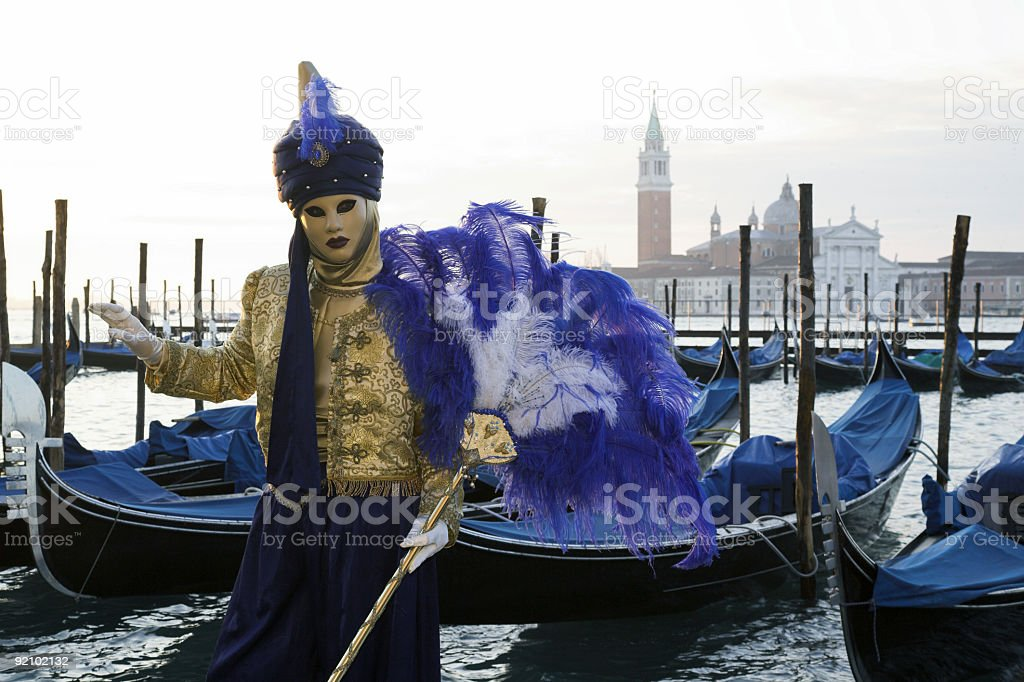 Middle Eastern mask at Grand Canal with gondolas in Venice royalty-free stock photo
