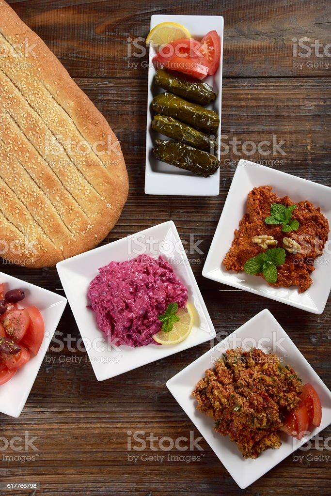 Middle Eastern Meze with Beet Tzatziki, Eetch, Muhammara, Barbari Flatbread stock photo