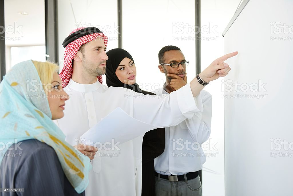 Middle eastern people having a business meeting at office royalty-free stock photo