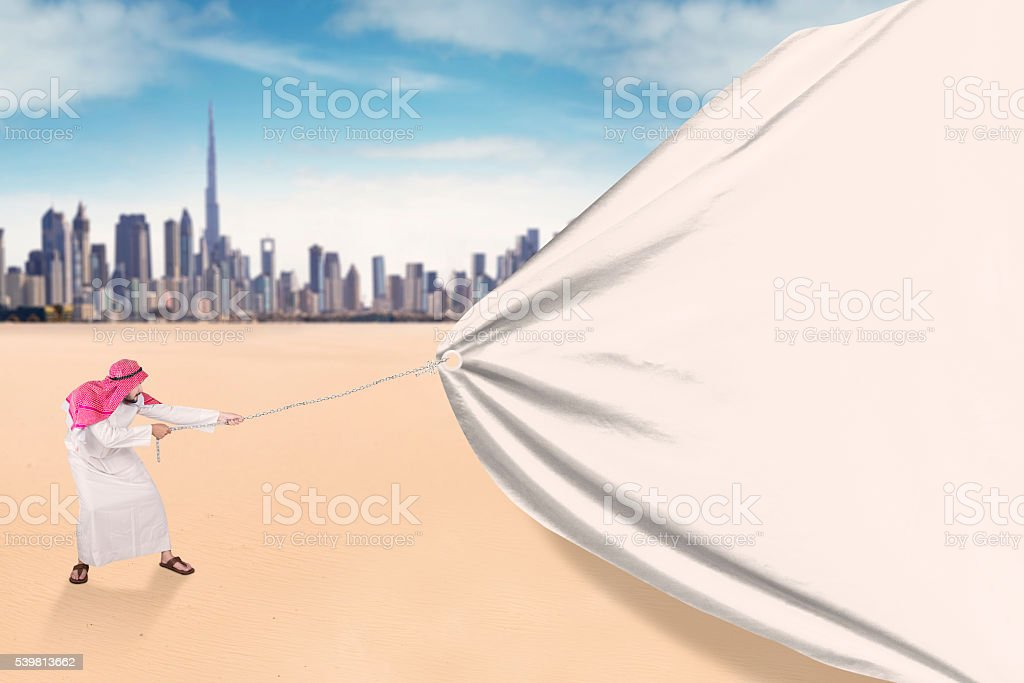 Middle eastern person pulling a big banner stock photo