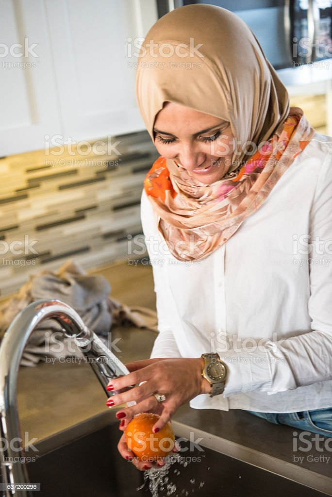 middle eastern woman at home stock photo