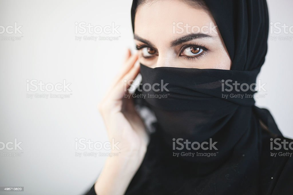Middle Eastern Woman Covering Her Face With Black Veil stock photo