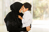 middle eastern woman playing with her son