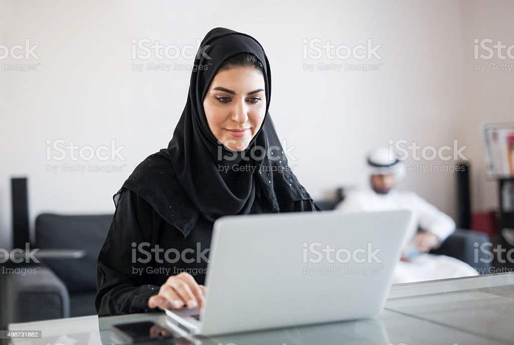Middle Eastern Woman Using Computer at Home stock photo