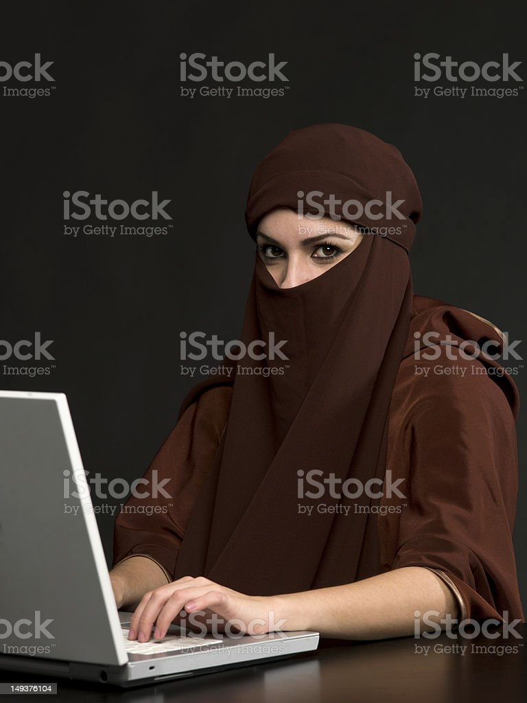 Middle Eastern Woman Using her Laptop royalty-free stock photo