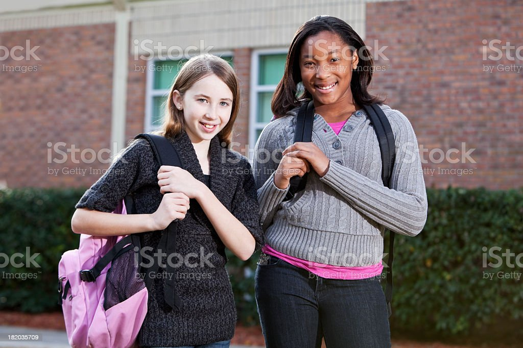 Middle school students outside with bookbags royalty-free stock photo