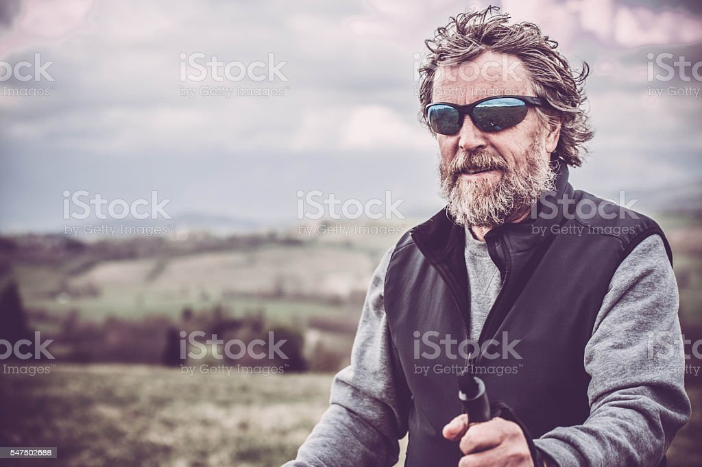 Middle-age man exercising with a Nordic walking technique portrait stock photo