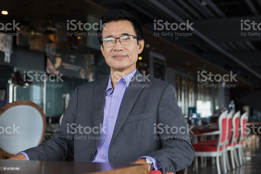 Middle-aged Asian Businessman in Restaurant stock photo
