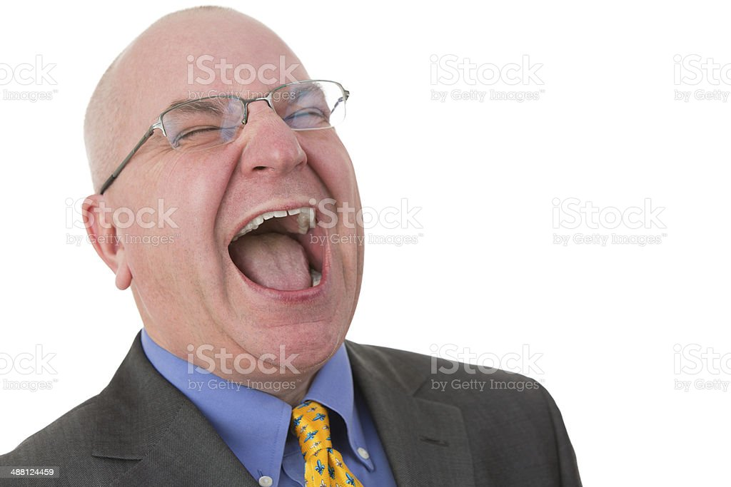 Middle-aged bald businessman laughing out loud stock photo