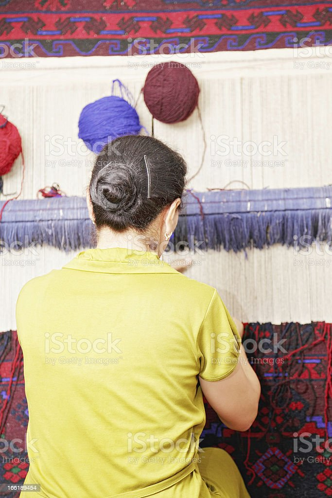 Middle-aged carpet weaver stock photo