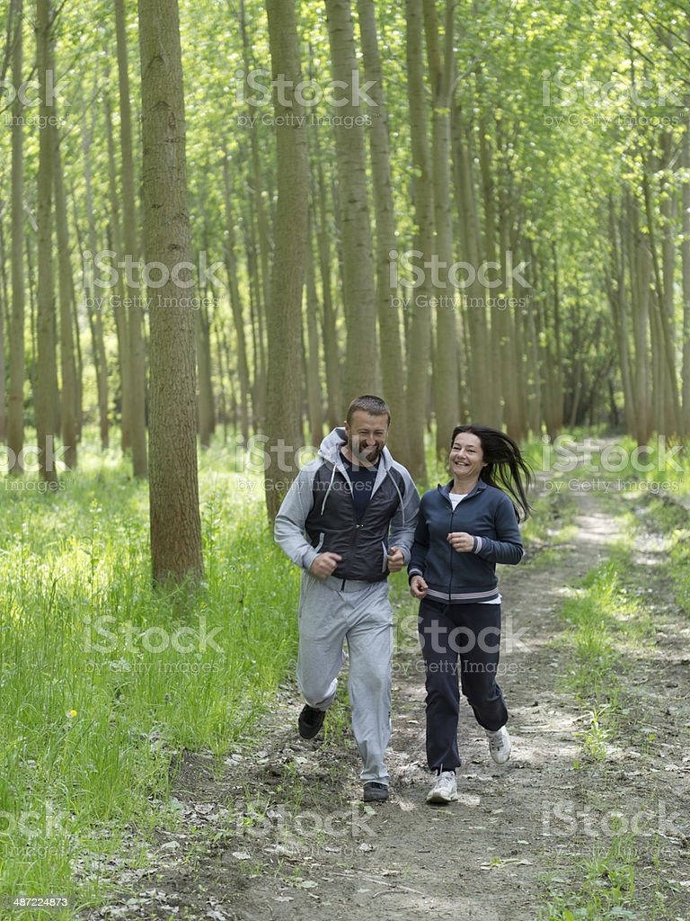 Middle-aged couple jogging. stock photo